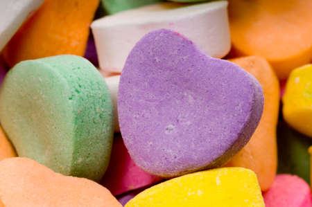 Extreme close-up of tiny candy hearts for Valentine's Day