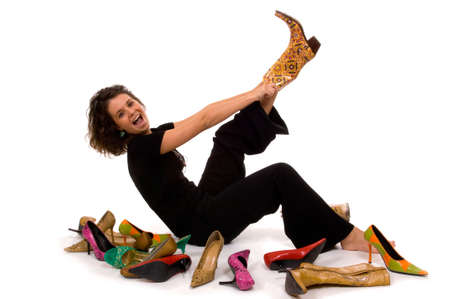 exasperation: Young, attractive, beautiful model trying on shoes on white background Stock Photo