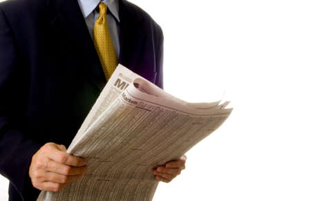 inform information: Business man reading business section of newspaper on white background Stock Photo