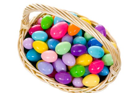 Easter Egg Basket with multicolored eggs on white background