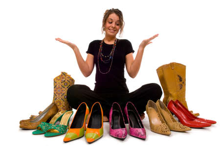 decide: Young pretty lady trys to decide what shoes to wear, decisions Stock Photo