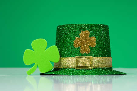 St. Patricks Day Decorations including a  green  leprechaun hat and a four leaf clover Stock Photo - 786656