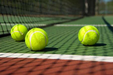 greenish: Bright greenish, yellow tennis ball on freshly painted cement court