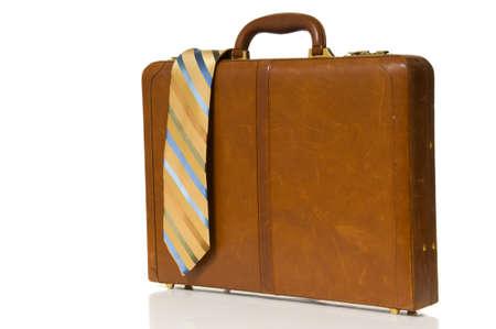 attache: Mans dress necktie on top of business briefcase, attache