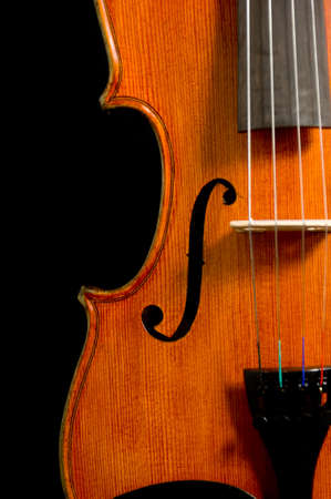artistry: Solid wood violin or fiddle on black background Stock Photo