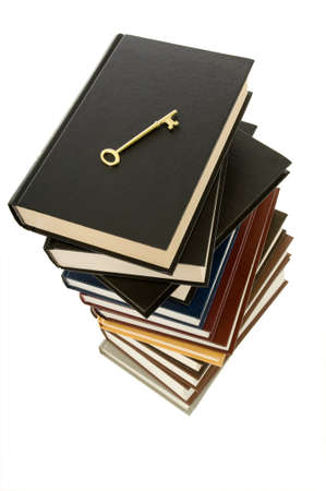 Huge stack of books with a skeleton key on top to signify the key to knowledge can be found in books Stock Photo - 1470078
