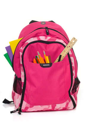 bookbag: Pink backpack with school supplies on white background with folders, pens, a ruler and glue Stock Photo