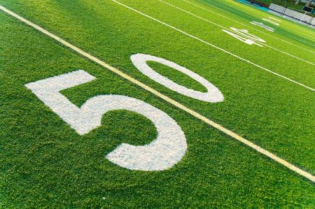 american football field: Closeup of 50 yard line on American football field