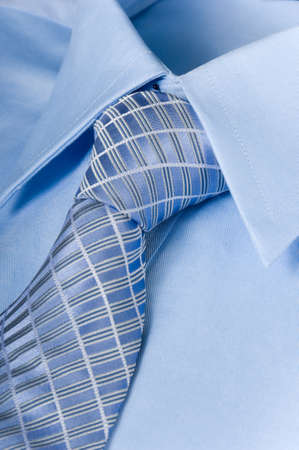 Man blue shirt and necktie background photo