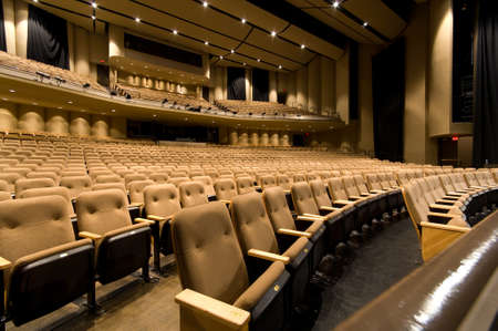 Large empty auditorium or theater with padded seating great background