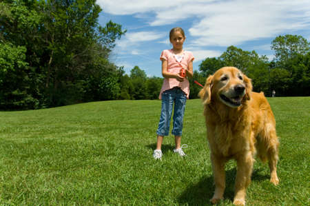 YOung girl at park with pet Dog Stock Photo - 1525885
