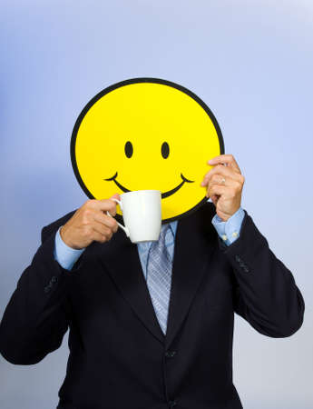smiley: Smiley face man drinking a cup of coffee -