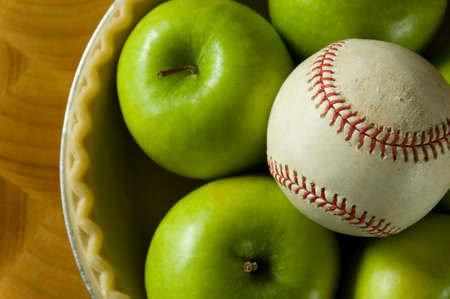 granny smith apple: Green granny smith apple in a pie crust with a a baseball, symbols of Amercan Summer, Baseball and apple pie Stock Photo