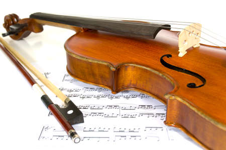 Violin and horsehair bow on sheet music