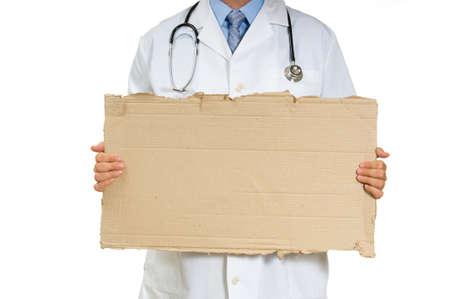医師または医師の段ボール記号 - 失業者の医師を保持