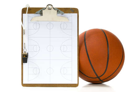 Clipboard, whistle, clipbaord and ball -  items a coach would use when coaching or teaching basketball on white background photo