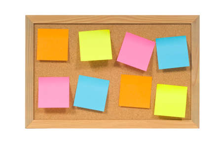 multicolored - flourescent colored post it or sticky notes on a bulletin - cork board.  with clipping path Stock Photo - 9601844