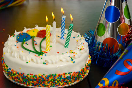 birthday candles: Decorated Birthday cake with candles and party hats