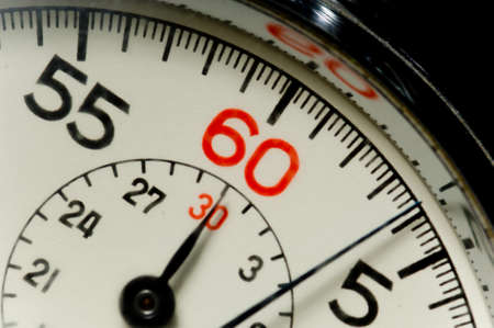 seconds: Close-up of 60 second stop watch- crystal of watch is scratched so numbers appear soft but image is in focus Stock Photo