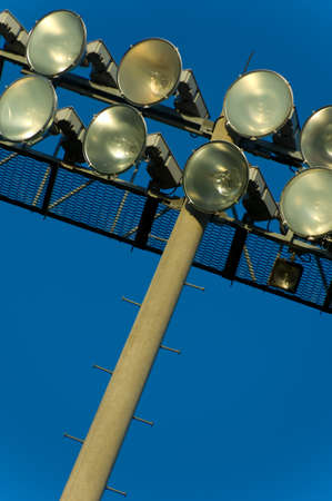 Light standard with flood lights at a stadium - with blue sky in the background - use as background