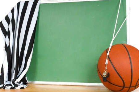 referees: Basketball game official or referee items including a basketball, a jersey a whistle and a chalkboard to add your own text