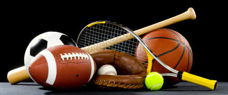 equipment: A variety of sports equipment on a black background including an american football, a soccer ball, a baseball, a baseball bat, a tennis raquet, a tennis ball, and a basketball