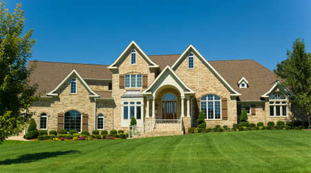 Beatuful two story home with  landscaped yard or lawn against blue sky