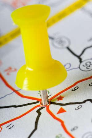 yellow pushpin: Yellow pushpin on map marking an intersection of several roads