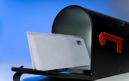 Mail box with blank letter against blue sky - stamp is fake and was created using one of photographers stock images Stock Photo - 1683776