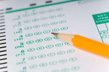 answer: Yellow Pencils lying on a computerized exam answer sheet Stock Photo
