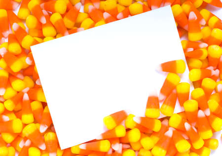 candy corn: A blank notecard, invitation, or announcement with candy corn