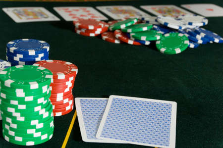 Gambling game with a game of Poker and several denomintions of chips