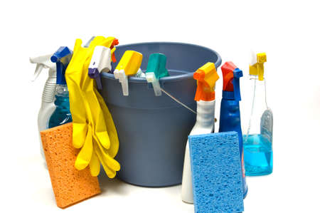 cleaning supplies: Cleaning supplies on white background including several spray bottles of chemicals, a bucket, gloves and sponges