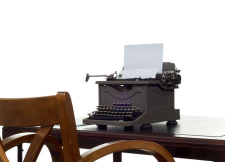 Old, antique, vintage, typewriter on desk with white background photo