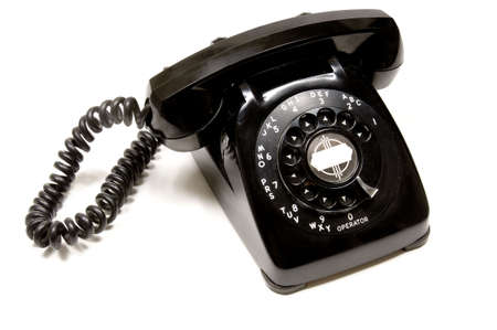 Vintage, antique black desk telephone on white background