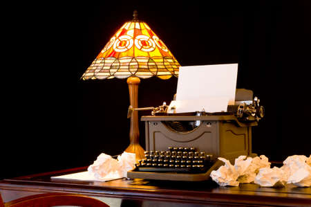 Old, vintage, antique, typewriter in wirters or authors work space with desk lamp, illustration of writers block illustration