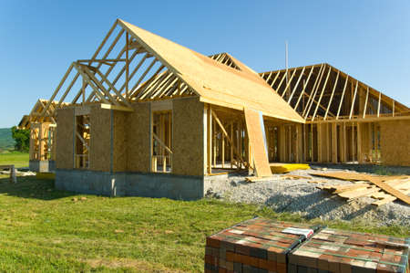 real esate: Image of Residential construction industry with image of house under construction Stock Photo
