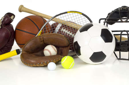 Variety of sports equipment on white background with copy space, items inlcude boxing gloves, a basketball, a soccer ball, a football, a baseball bat, a catchers mitt or glove, a tennis racket and ball, a golf ball, and a baseball catchers mask