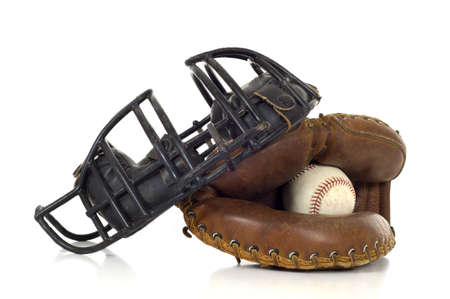 catcher's mitt: Baseball Catchers gear on white background including a mitt, ball and face mask Stock Photo