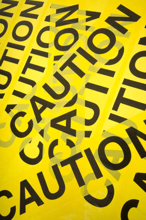 barrier: Yellow barrier tape with the word Caution, great background