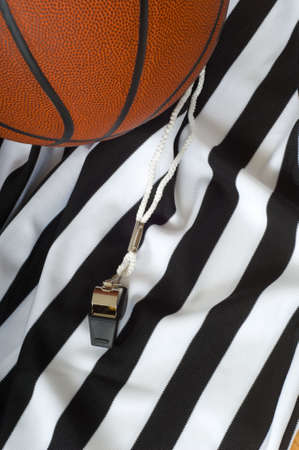 A referee jersy with a whistle and a basketball, basketball referees equipment