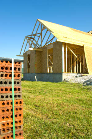 Image of Residential construction industry with image of house under construction Stock Photo