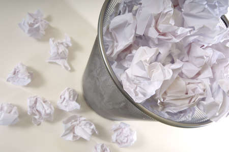 An overflowing waste basket full of crumpled pieced of paper Stok Fotoğraf