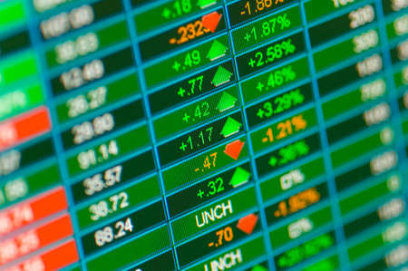 A close-up of a monitor showing financial stock market information, financial markets background Stock Photo