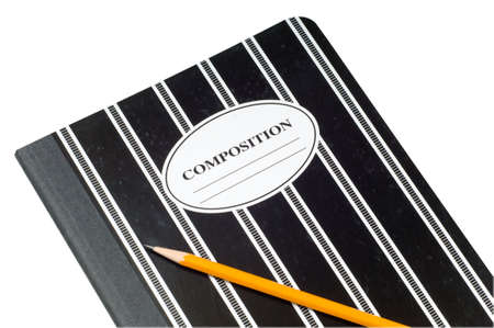 composition notebook: A black and white striped composition book and a yellow pencil on a white background, copy space on cover of notebook