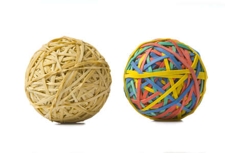 rubberband: Two rubberband balls, illustration of opposites, or being different and refusing to be ordinary or boring Stock Photo