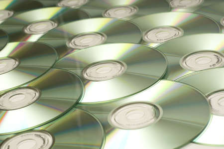 gigabytes: a stack of several compact disk for a technology background etc.