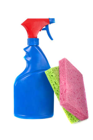 A red and blue blank spray bottle with a  multicolor sponges, spring cleaning etc with copy space
