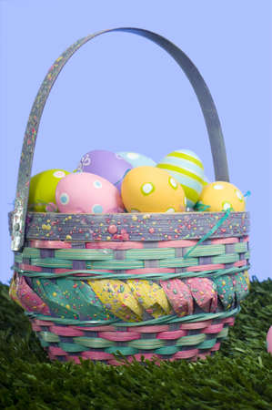 Brightly colored Easter eggs in a basket