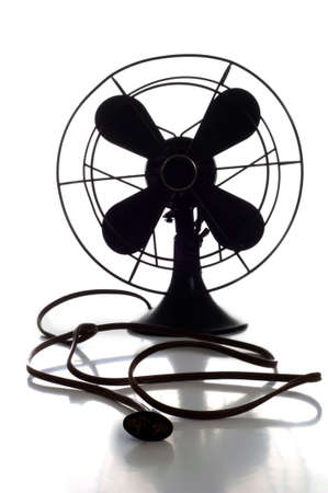 Antique fan on white background photo